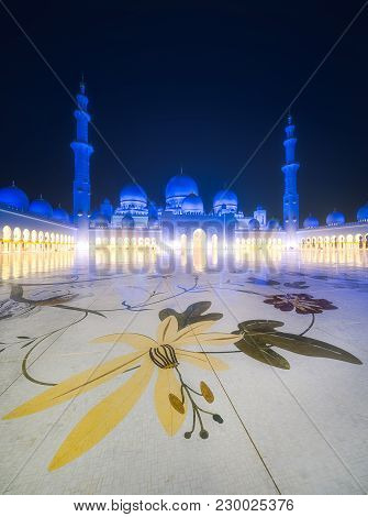 View Of Floral Pattern On The Floor Of Sheikh Zayed Grand Mosque At Dusk, Abu-dhabi, Uae