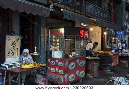 Xian, China - August 5, 2012: People Selling Food In A Street Market At The Muslim Quarter In The Ci