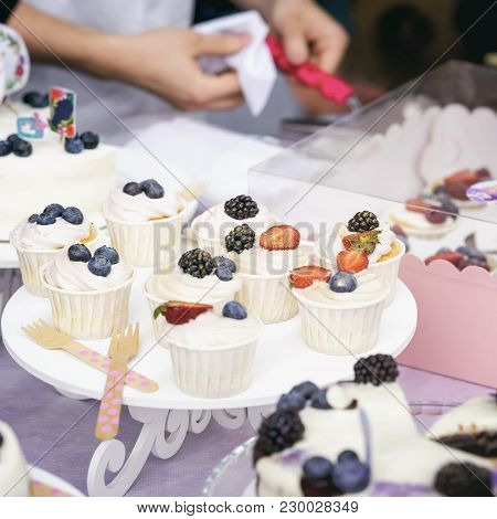 Different Appetizing Tartlets, Cake Basket With White Cream And Fresh Multi-colored Berries, Summer
