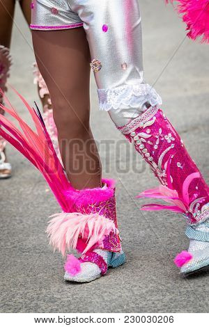 Male Legs Wearing Masquerade Boots During Carnival Parade In Caribbean