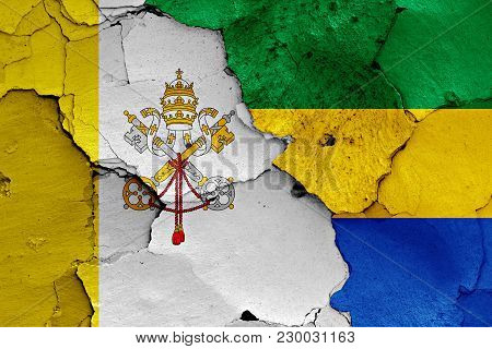 Flag Of Vatican And Gabon Painted On Cracked Wall