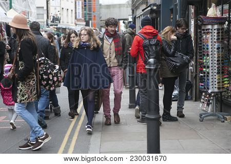 London, Uk - April 22, 2016: Two Hipster Girls Dressed In Cool Londoner Style Walking In Brick Lane,