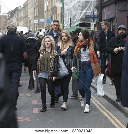 London, Uk - April 22, 2016: Hipsters Girls Dressed In Cool Londoner Style Walking In Brick Lane, A