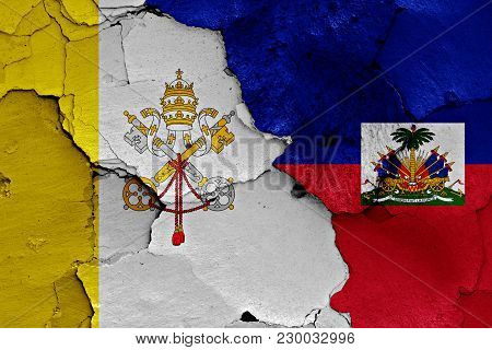 Flag Of Vatican And Haiti Painted On Cracked Wall