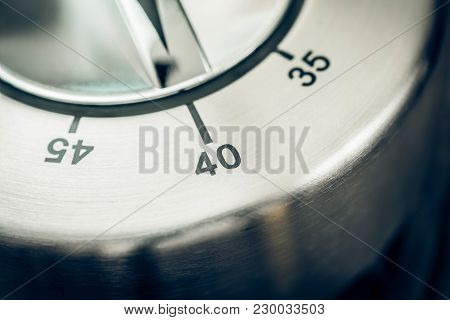 40 Minutes - Macro Of An Analog Chrome Kitchen Timer On Wooden Table
