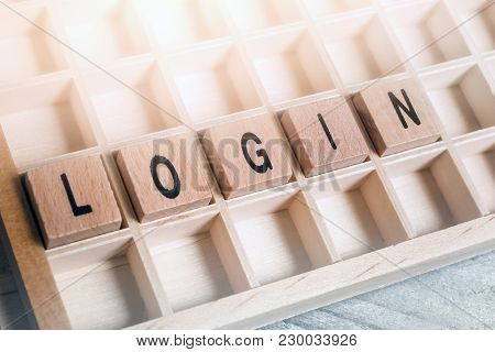 Closeup Of The Word Login Formed By Wooden Blocks In A Typecase