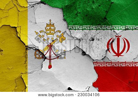 Flag Of Vatican And Iran Painted On Cracked Wall