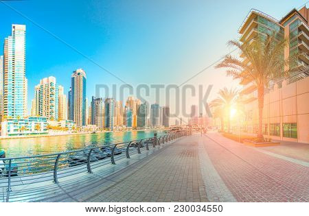 Seafront In Dubai In The Morning. Tall Skyscrapers Illuminated By Rising Sun. Stunning Cityscape.