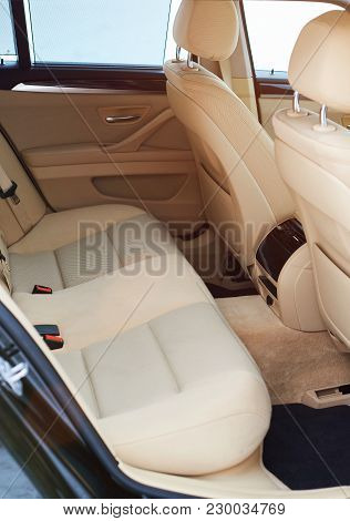 Back Empty Space In Modern Car. Clean Brown Seat On Vehicle