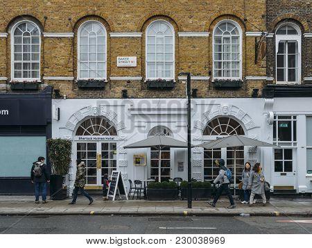 London, Uk - Mar 4, 2018: Pedestrians Walk Past The Sherlock Holmes Hotel On Baker Street. The Ficti