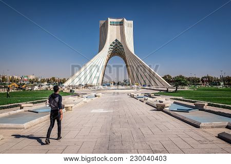 Tehran, Iran - October 15, 2016: Man Walks In Front At Azadi Square With Azadi Tower In Tehran