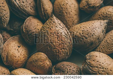 Shelled Almonds Nuts As Background. Heap Of Almonds Texture And Background For Design. Close Up View