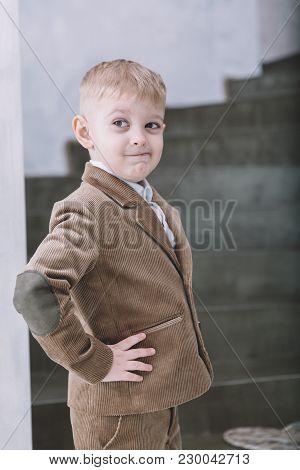 Cute Little Boy Dressing In Brown Velvet Suit. Stylish Boy. Cute Blonde-hair Boy. Kids Emotions Conc