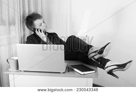 Bussiness Woman Speaking By Mobile Phone And Working At Office