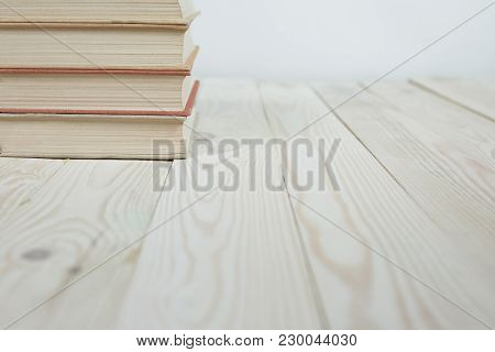 Pile Of Old Books Stacked On Top Of Each Other. Selective Focus With Copy Space