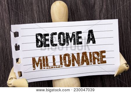 Word, writing, text  Become A Millionaire. Conceptual photo Ambition To Become Wealthy Earn Fortune Fortunate written torn paper holding by sculpturethe wooden background poster