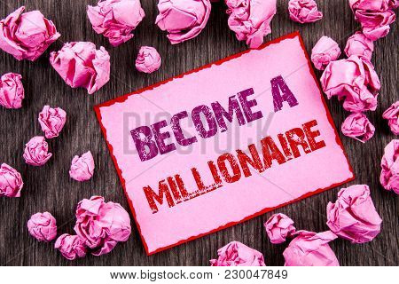 Handwriting text showing Become A Millionaire. Business photo showcasing Ambition To Become Wealthy Earn Fortune Fortunate written Pink Sticky Note Paper Folded Paper wooden background poster