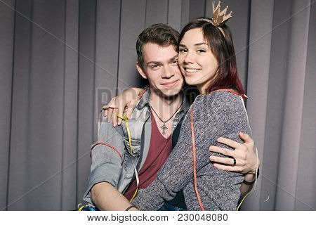 Cheerful Couple Having Fun, Making Photos Together, Laughing, Touching Each Other. Young People In L