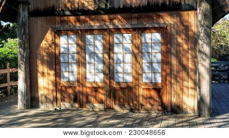 Old Wooden Farm Shed With Great Afternoon Shadows..