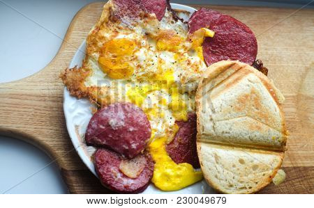 An Omelette With Bacon And Toast. English Breakfast