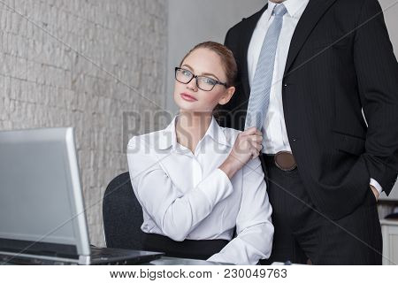 Young Smart Secretary Pulling Boss By Tie In Office, Gold Digger, Lovers