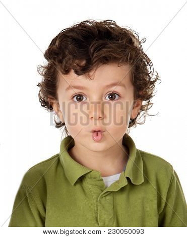 Funny child doing a grin puting his lips together isolated on white background