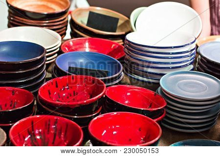 Plates On The Counter In The Market. Ceramics For Home, Dishes, Plates, Cups.
