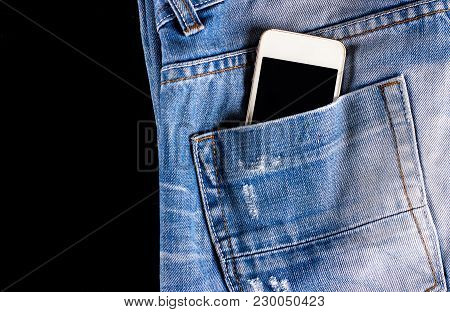 Blue, Worn Jeans And A Phone In The Back Pocket