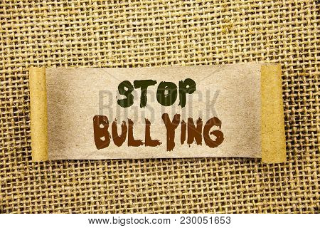 Writing text showing  Stop Bullying. Business photo showcasing Awareness Problem About Violence Abuse Bully Problem written Tear Sticky Note Paper the textured background poster