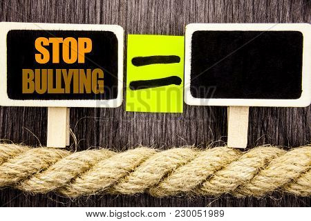 Ttext showing Stop Bullying. Business concept for Awareness Problem About Violence Abuse Bully Problem written Blackboard Equatispace for your text the wooden background. poster