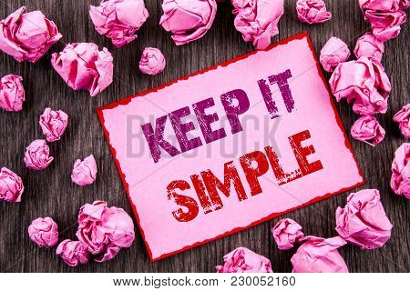 Handwriting text showing Keep It Simple. Business photo showcasing Simplicity Easy Strategy Approach Principle written Pink Sticky Note Paper Folded Paper wooden background poster