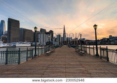 San Francisco Skyline And Boardwalk Sunset. Pier 7, San Francisco, California, Usa.