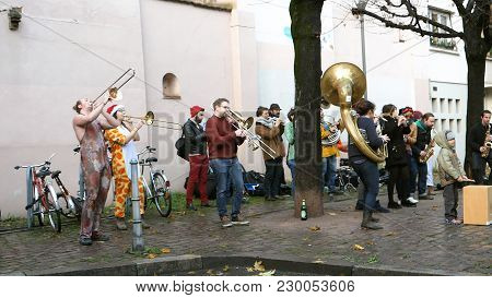 Strasbourg, France - Jan - 12, 2018: Street Music Orchester Dressed In Funny Clothes On The Streets