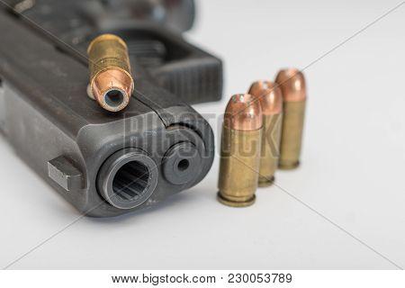 Hand Gun Up Close With Ammuntion Laying Around It