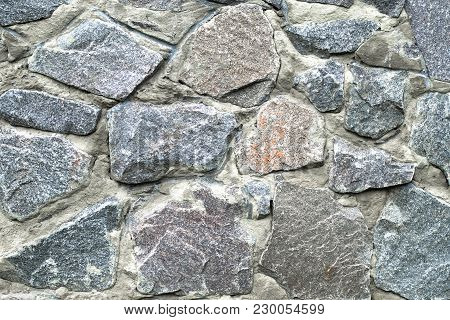 Texture Of A Stone Wall. Can Be Used As A Background For A Typography Design Or Texture In Computer