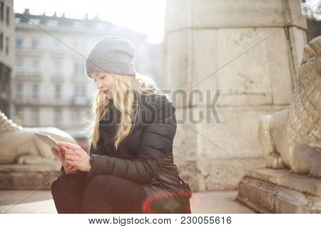 Blonde woman using a tablet