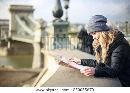 Girl looking at the map