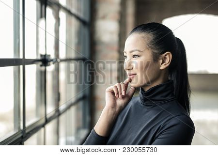 Young woman at the window