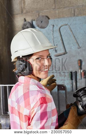 Woman as blue collar worker apprentice with labor protection
