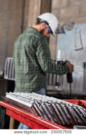 Metal factory with metalworker during metallurgy production