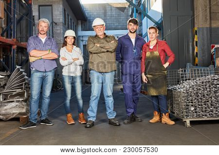 Successful group or team of blue collar workers as colleagues