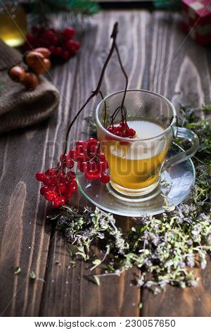 Herbal Vitamin Herbal Tea With Thyme In A Transparent Glass Mug On A Wooden Table