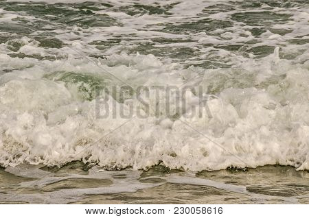Close-up Of Waves In The Atlantic Ocean Rushing To Shore