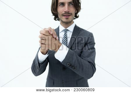 portrait of bearded business man rubbing his hands together