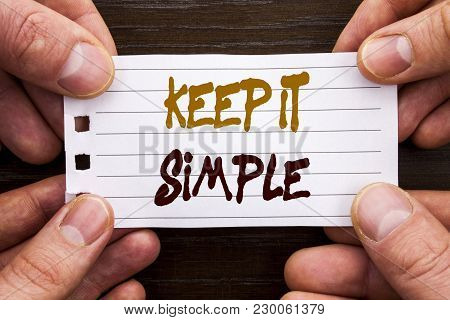 Handwritten text sign showing Keep It Simple. Business concept for Simplicity Easy Strategy Approach Principle written Sticky Note Paper Holding Hand with Finger. poster