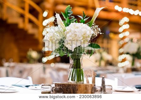 Winter Wedding Reception With Beautiful Flower Centerpieces And Number Seating Assignment Tags In Or