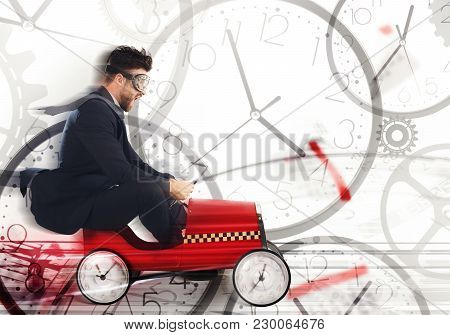 Business Man Drive Fast A Car With Clock Wheels Surrounded By Clocks