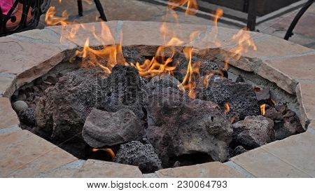 A Patio Fire Pit Creating A Warm And Cozy Atmosphere.