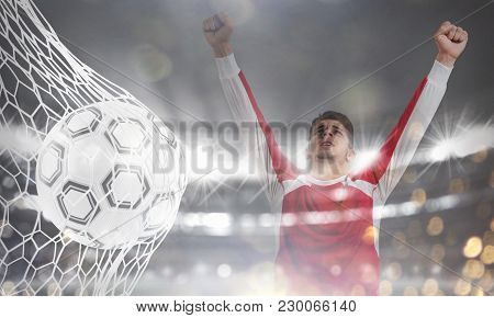 Double Exposure Image With A Ball Pierces The Soccer Goal At The Stadium During A Night Match And A