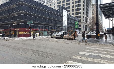 Busy Chicago Street Intersection Being Cleared Of Snow In Winter After A Snowstorm With A Case 40xt